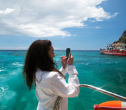 Young woman photographs the island in Greece Royalty Free Stock Images