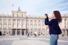 Young woman photographs palace of Spanish kings. In Madrid, Spain royalty free stock images