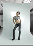 Young woman in the photostudio Royalty Free Stock Photography