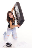young woman at piano Stock Photo