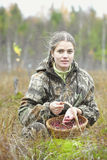 Young woman pick cranberry on a bog. Stock Image