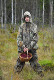 Young woman pick cranberry on a bog. Stock Photography