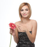 A young woman picking pettals from a flower Royalty Free Stock Photos