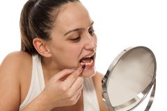 Woman picking her teeth Royalty Free Stock Photos