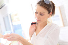 Young woman picking up  clothes in a store Royalty Free Stock Photography