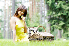 Young woman on a picnic Royalty Free Stock Image