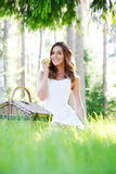 Young woman on a picnic Royalty Free Stock Images