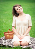 Young woman picnicing in the park Stock Image