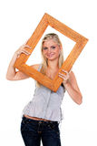 Young Woman with Picture Frame Around Face Stock Photography