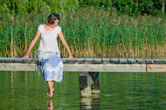 Young Woman On Pier Royalty Free Stock Images