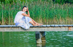 Young Woman On Pier Stock Images