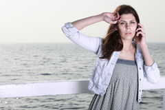 Young woman on the pier Royalty Free Stock Image