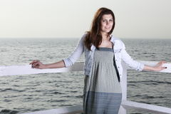 Young woman on the pier Royalty Free Stock Photos