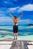 Young woman on the pier near the ocean Stock Photos