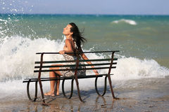 Young woman on the Pier. Woman on pier standing on a metallic bench Stock Photography