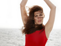 Young woman on the pier wind in hair Stock Images