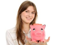 Young woman  with piggy bank Royalty Free Stock Image
