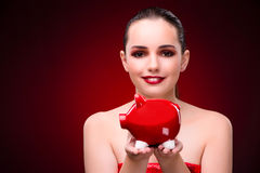 The young woman with piggy bank Royalty Free Stock Photo