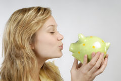 Young woman with piggy bank Royalty Free Stock Photos