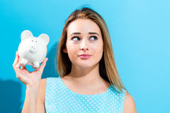 Young woman with a piggy bank Stock Image