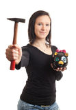 Young woman piggy bank hammer Stock Photography