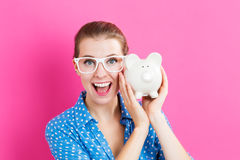Young woman with a piggy bank Stock Photography