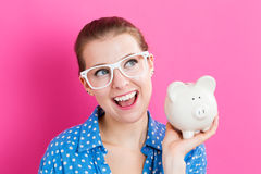 Young woman with a piggy bank Stock Images