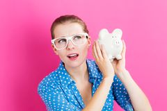 Young woman with a piggy bank Royalty Free Stock Images