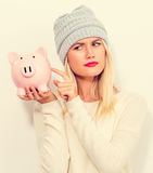 Young woman with a piggy bank Royalty Free Stock Photos