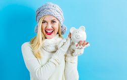 Young woman with a piggy bank Royalty Free Stock Photography
