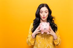 Young woman with a piggy bank stock photo