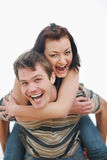 Young woman piggybacking boyfriend Royalty Free Stock Photography