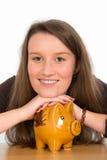 Young woman with piggybank Stock Image