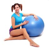 Young woman with pilates ball. Royalty Free Stock Photos