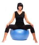 Young woman with pilates ball. Stock Photos