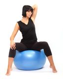 Young woman with pilates ball. Royalty Free Stock Photo