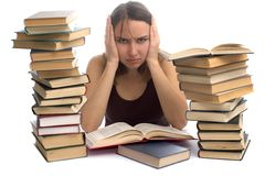 Young woman and a pile of books Stock Photos