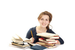 Young woman and a pile of books Royalty Free Stock Photography