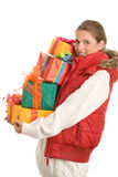 Young woman with pile of gifts Royalty Free Stock Photos