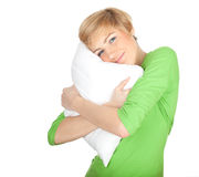 Young woman with pillow Royalty Free Stock Photos