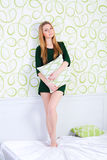 Young woman with pillow. Portrait of young woman with pillow royalty free stock photography