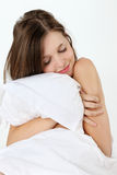 Young woman with pillow. Young teen woman with pillow Stock Photo