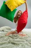Young woman with pillows Royalty Free Stock Photos
