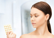 Young woman with pills Stock Photos