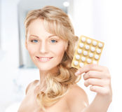 Young woman with pills Stock Photography