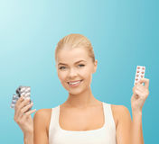 Young woman with pills Royalty Free Stock Image