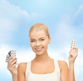Young woman with pills Stock Photo