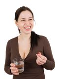 Young woman with pills in hand Stock Image