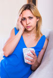 Young woman with pills at home Royalty Free Stock Images
