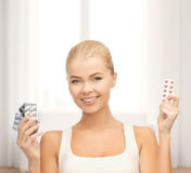 Young woman with pills Royalty Free Stock Photos